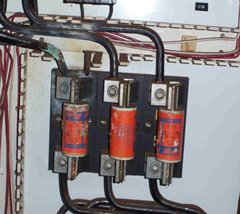 High Resistance Line side of fuse. Note heat damage to connection and adjacent phase cabling above.