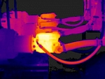 Inspecting a pump with an infrared camera.