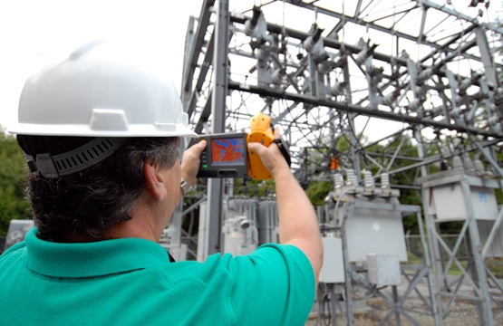A thermographer taking shots of a substation.